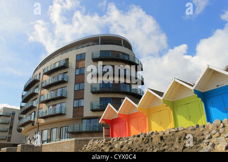 Scenic view of colorful chalet buildings with modern hotel in background, Scarborough, England. - Stock Photo
