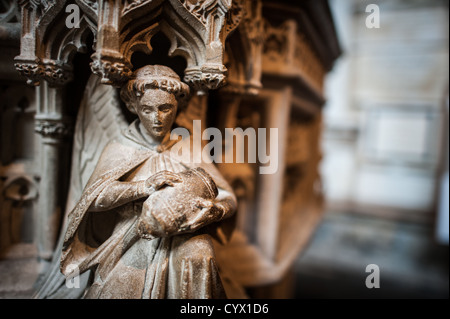 BATH, UK - And angel carved into the base of the pulpit in Bath Abbey. Formally the Abbey Church of Saint Peter - Stock Photo