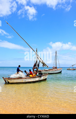 Fishermen ready their nets for a days fishing on Inhaca Island Mozambique - Stock Photo