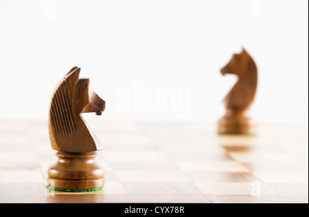 Close-up of chess knights on a chessboard - Stock Photo