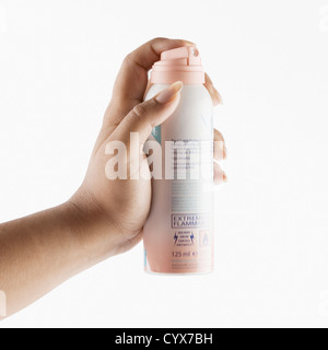 Close-up of a woman's hand holding a deodorant - Stock Photo