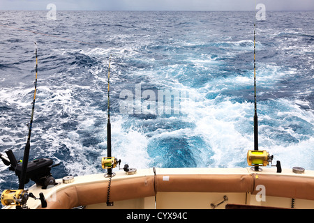 The view from the after deck of a sport fishing boat with rods set for fishing Mozambique Inhaca Island - Stock Photo