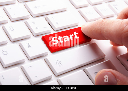 start button or key on keyboard showing go or power concept - Stock Photo