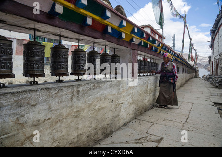 Woman prays using prayer wheels Asia Asian Classic Classical Cultural Cultures Female Women Girl Lady Historical - Stock Photo