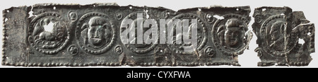 Decorative Roman sheet metal plates, 3rd/4th century AD. Bronze with dark patina. Two pieces of a sheet metal strip - Stock Photo