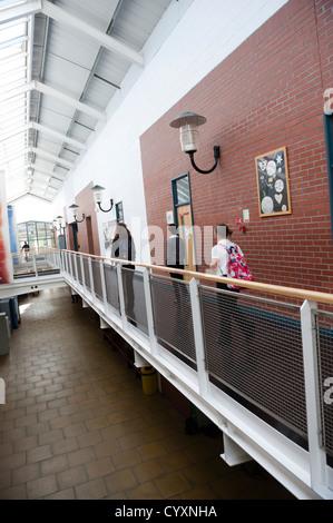Pupils in the hallway corridor of a secondary comprehensive school, Wales UK - Stock Photo