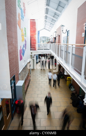 Blurred pupils rushing moving in the hallway corridor of a secondary comprehensive school, Wales UK - Stock Photo