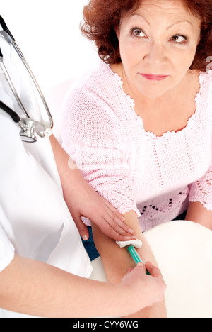 Senior female getting blood analysis. - Stock Photo