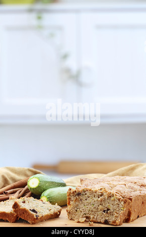 Delicious homemade zucchini bread with whole zucchini fresh from the garden. - Stock Photo