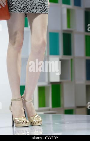 Woman With Long Legs And High Heels In Short Tartan Skirt