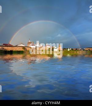 Rainbow over Monastery. Spaso-Preobrazhenskiy solovetsky monastery. Solovetsky Archipelago, White Sea, Korelia, - Stock Photo