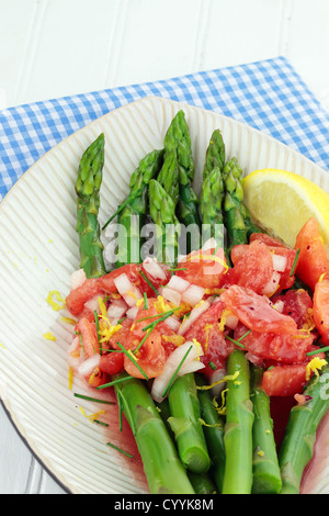 Freshly picked asparagus steamed and served with a tomato and raspberry vinaigrette. - Stock Photo