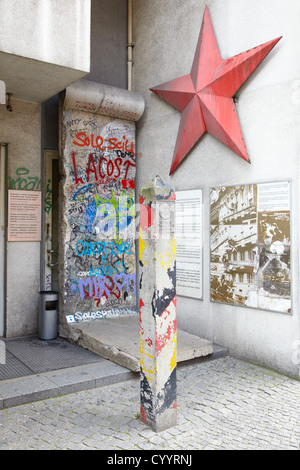 DDR plaque and red star in Berlin - Stock Photo