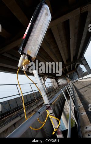 A service road site lighting, trackside in the Britannia railway bridge, Wales - Stock Photo