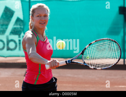 Young woman playing tennis in a holiday club, Manavgat, Turkey - Stock Photo
