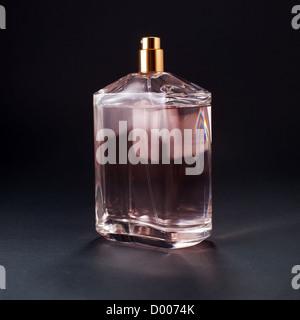 Womens perfume bottle full of fragrance (eau de parfum) - Stock Photo