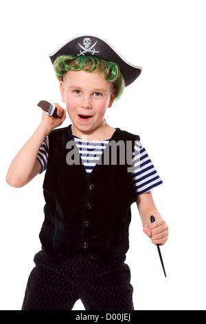 Boy wearing pirate costume holding knifes isolated on white - Stock Photo