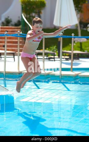 Girls shouting in splashing water at water park stock - Swimming pool girl christmas vacation ...