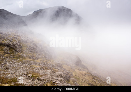 Broad Crag surrounded by cloud in the English Lake District, England, UK. - Stock Photo