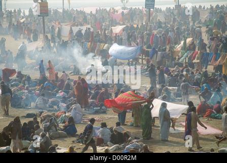 Pilgrims drying off after bathing in the area behind the Sangam, Maha Kumbh Mela 2001, Allahabad, Uttar Pradesh, - Stock Photo