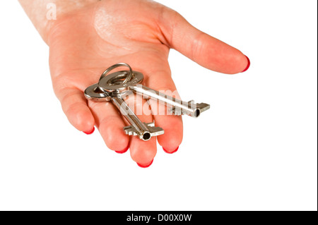 Isolated two safety box door keys in hand on white background - Stock Photo