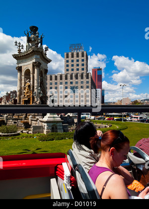 Tourists on an open top double decker sightseeing bus in Barcelona city centre Catalonia Spain - Stock Photo