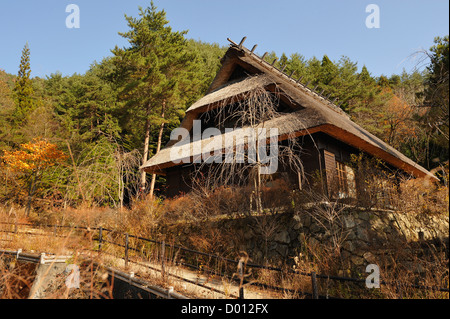 Traditional thatched Japanese farmhouse in the village of Iyashi no Sato, Mt Fuji region, Japan - Stock Photo