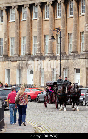 people look at a traditional 18th century horse and carriage in Royal Crescent, Bath Somerset UK - Stock Photo