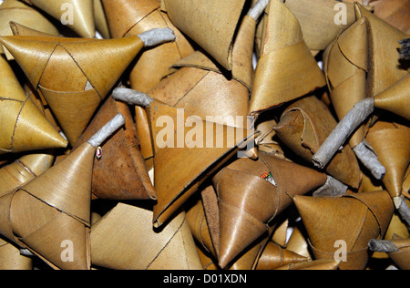 Coconut Leaf wrapped Traditional Homemade crackers used for Fireworks during the Occasion of Diwali Festival at - Stock Photo