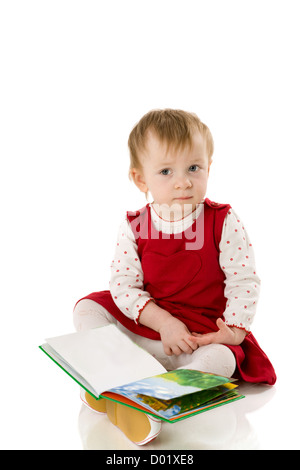 Baby girl holding book and laughing isolated on white - Stock Photo
