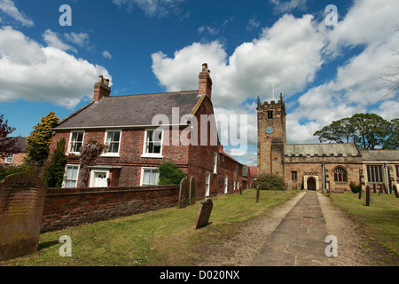 All Hallows' Church and house at Sutton on the Forest, north, yorkshire - Stock Photo