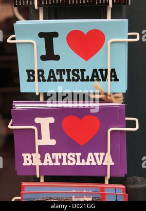 'I love Bratislava' postcards on sale outside a tourist shop in Bratislava, Slovakia. - Stock Photo