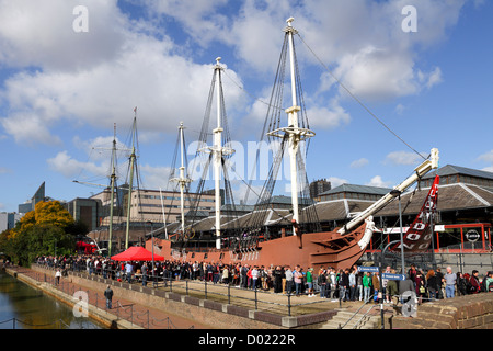 Hoards of people queue to gain entrance to The London Tattoo Convention in Wapping, London - Stock Photo