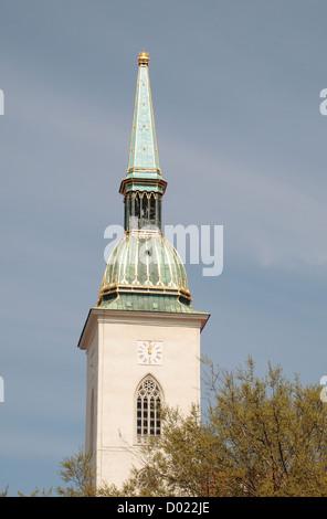 The spire of St. Martin's Cathedral from Rybné námestie Square , Bratislava, Slovakia. - Stock Photo