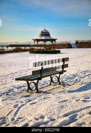 Magdalen Green Bandstand and bench covered in snow, Dundee, Scotland - Stock Photo
