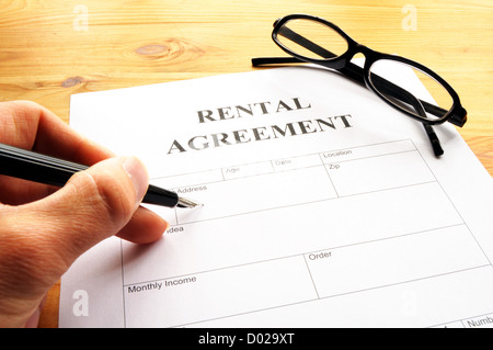 rental agreement form on desktop in business office showing real estate concept - Stock Photo