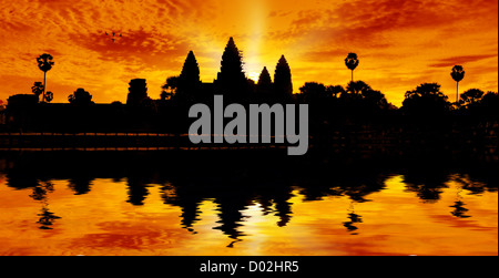 Silhouette of Angor Wat temple in the sunrise - Stock Photo