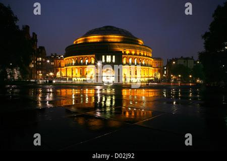 Royal Albert Hall lit up at night, South Kensington, London, UK - Stock Photo
