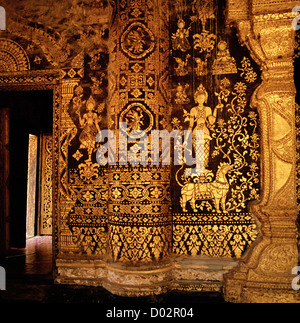 Buddhist temple art and design at Wat Xieng Thong Temple in Luang Prabang in Laos in Indochina in Far East Southeast - Stock Photo