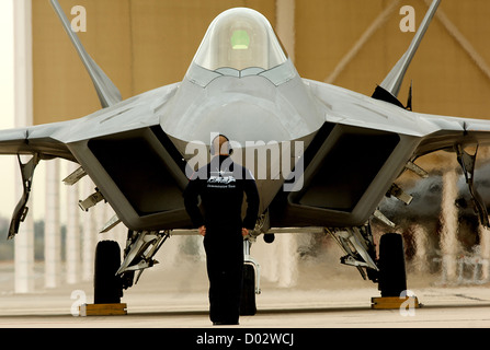 A crew chief for the F-22 Raptor Demonstration Team prepares the airman for takeoff during the Heritage Flight Conference - Stock Photo