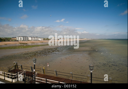 View of the beach and East Worthing from the end of Worthing Pier, West Sussex, UK - Stock Photo