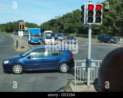 Suburban traffic flow, stationary at a traffic light road intersection in Galway City in the West of Ireland. - Stock Photo