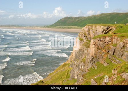 People on a cliff, waves, beach, Rhossili Bay, Gower Peninsula, Wales, United Kingdom, Europe - Stock Photo