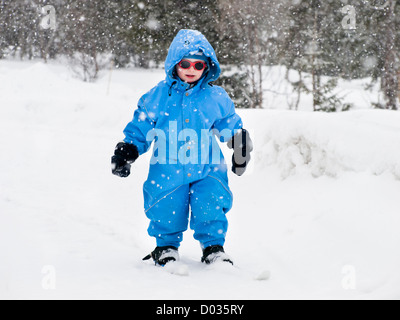 Three year old boy learning to ski, cross country Nordic skiing, first attempts, forest near Oslo Norway, heavy - Stock Photo