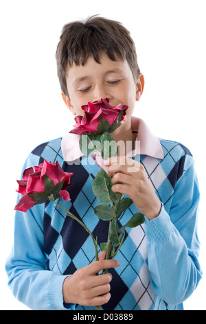 Boy smelling a flower isolated on white - Stock Photo