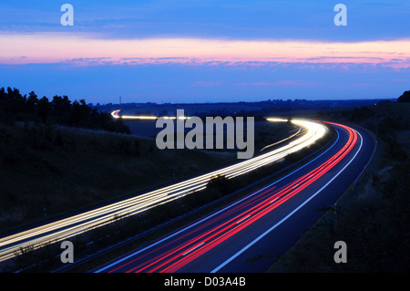 night traffic motion blur on highway showing car or transportation concept - Stock Photo