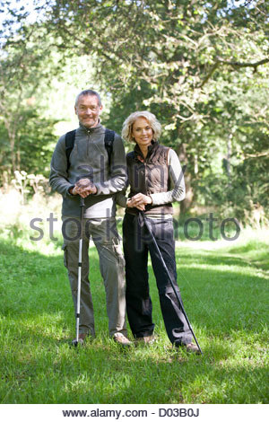 A mature couple standing in the countryside together - Stock Photo