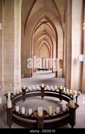 Candles in the nave of the Cistercian monastery Kiedrich, Rheingau, Hesse, Germany - Stock Photo