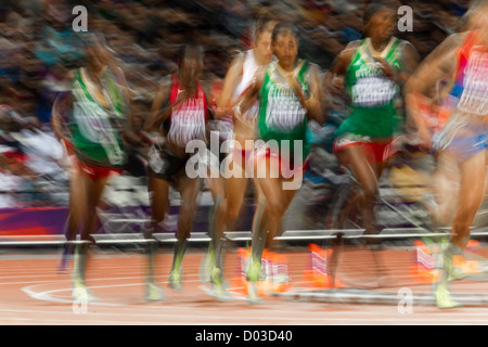 Blurred action of women competing in the Women's 3000m Steeplechase at the Olympic Summer Games, London 2012 - Stock Photo