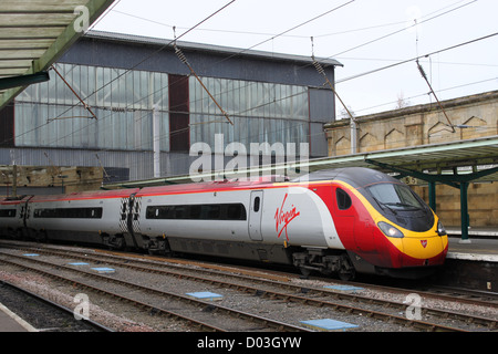 Class 390 Virgin Pendolino electric multiple unit train at Carlisle station on a service to Glasgow Central. - Stock Photo